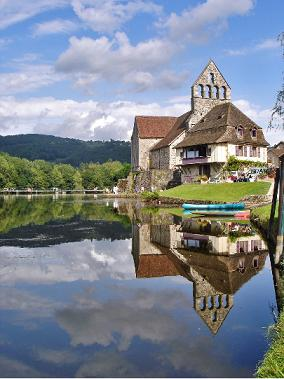 Castle by a lake in the French Dordogne